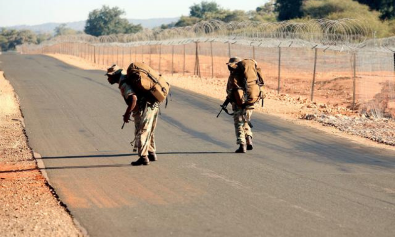 In this file photo, South African National Defence Force members patrol along the fence of Beit Bridge border. — Reuters