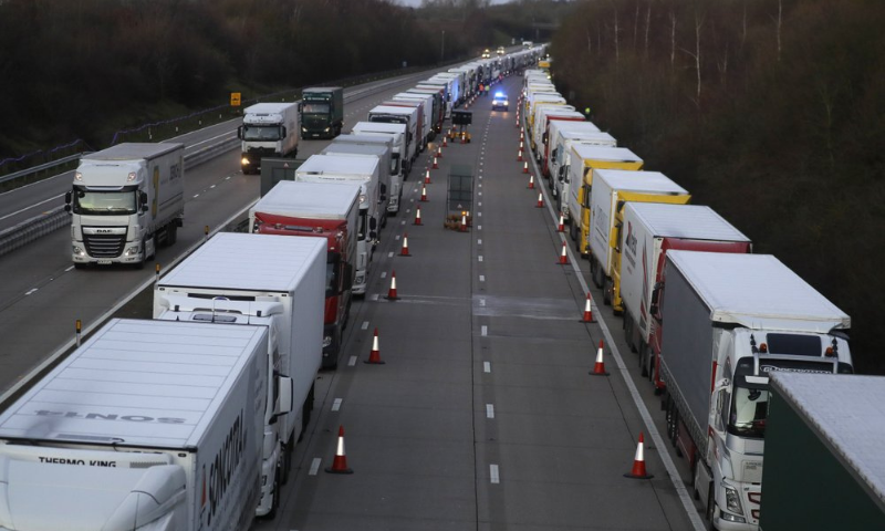 Trucks are parked up on the M20, as more arrive to join the queue, part of Operation Stack in Ashford, Kent, England on Friday. — AP