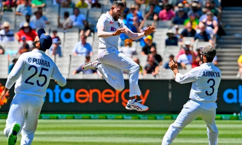 India's Mohammed Siraj (C) celebrates dismissing Australia's Marnus Labuschagne on the first day of the second cricket Test match between Australia and India played at the MCG in Melbourne on December 26. — AFP