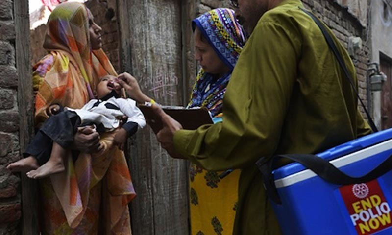 A health worker administers the polio vaccine to a child during a vaccination campaign in Lahore. — AFP/File