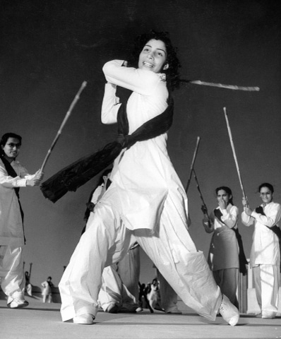 Zeenat Rashid, the then captain of the Sind Women's National Guard, practising how to use a lathi in Karachi on November 1, 1947. — Courtesy Seafield Archive