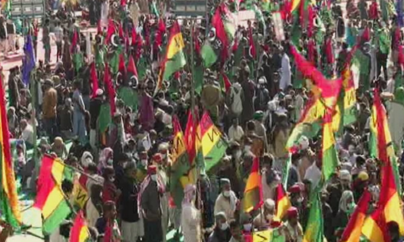 Party workers arrive at the venue for the rally in Larkana. — DawnNewsTV