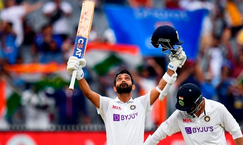 India's Ajinkya Rahane celebrates scoring his century as teammate Ravi Jadeja (R) looks on during the second day of the second Test match between Australia and India at the MCG in Melbourne on December 27. — AFP