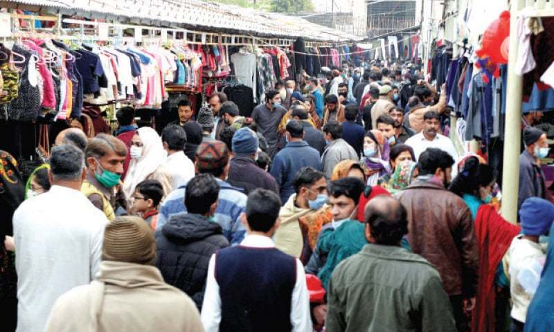 In this Nov file photo, people crowd the weekly bazaar in Islamabad's Aabpara area on Sunday in total disregard to the health guidelines to protect against Covid-19. — Photo by Mohammad Asim