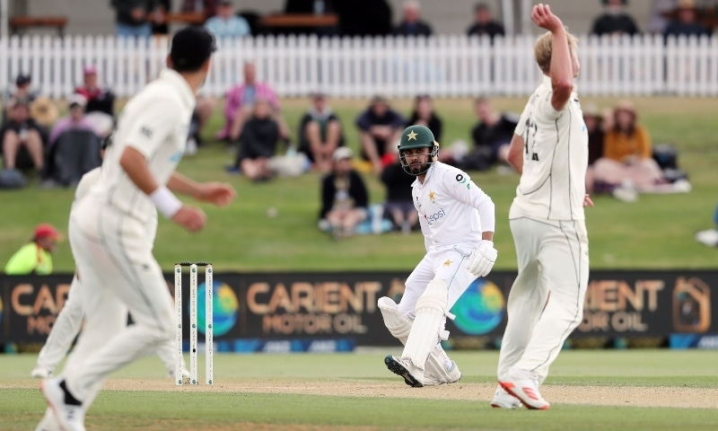 Pakistan batsman Faheem Ashraf (C) looks to avoid the throw from New Zealand's Kyle Jamieson (R) on day three of the first Test match between New Zealand and Pakistan at the Bay Oval in Mount Maunganui on December 28. — AFP