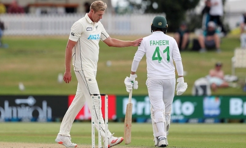 New Zealand's Kyle Jamieson (L) gestures as Pakistan batsman Faheem Ashraf walks back to bat on day three of the first Test. — AFP