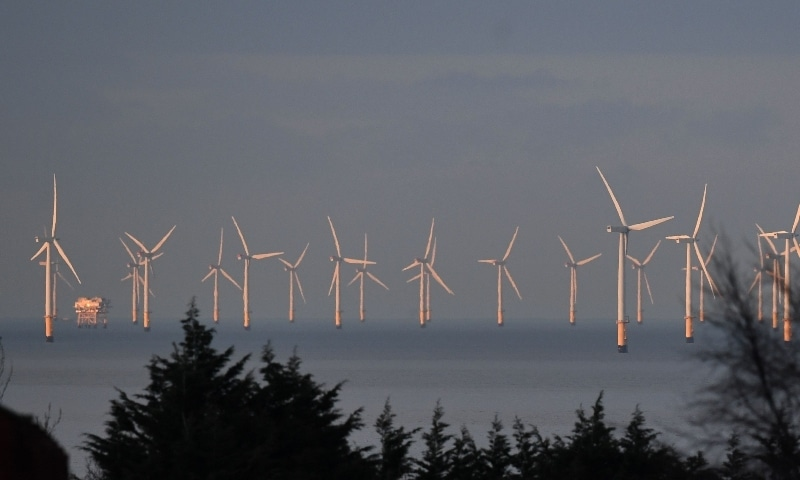 In this file photo, wind turbines stand in the Irish Sea at the Gwynt y Mor Offshore Wind Farm, off the coast of Colwyn Bay, north Wales. — AFP