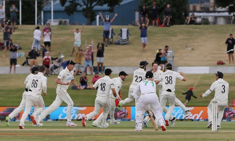 New Zealand celebrate their victory after taking the final wicket on the fifth day of the first cricket Test match between New Zealand and Pakistan at the Bay Oval in Mount Maunganui on December 30. — AFP