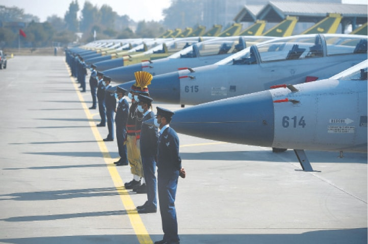 PERSONNEL of the Pakistan Air Force stand in a row near the 14 dual-seat JF-17B multi-role aircraft rolled out at a ceremony on Wednesday at the Pakistan Aeronautical Complex in Kamra.—AFP