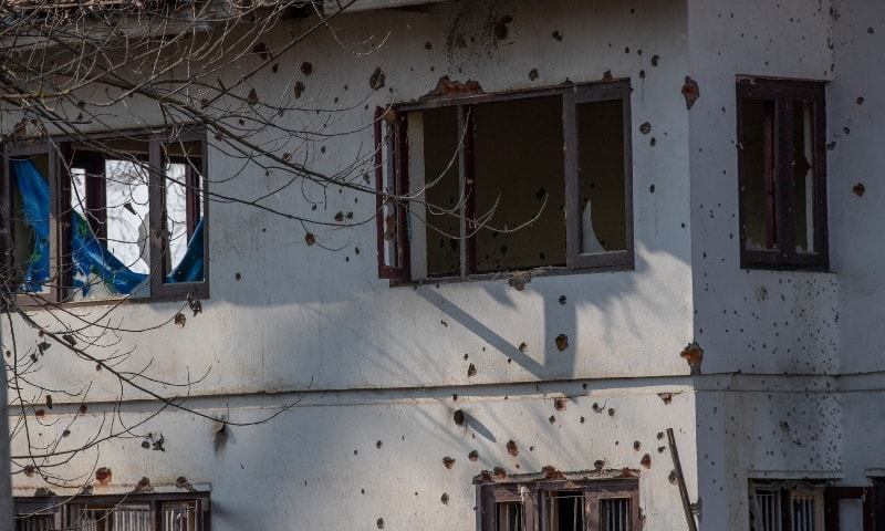 Bullet marks cover the wall of a building where Indian forces allege suspected fighters had taken refuge, after a gun battle on the outskirts of Srinagar, Wednesday. — AP