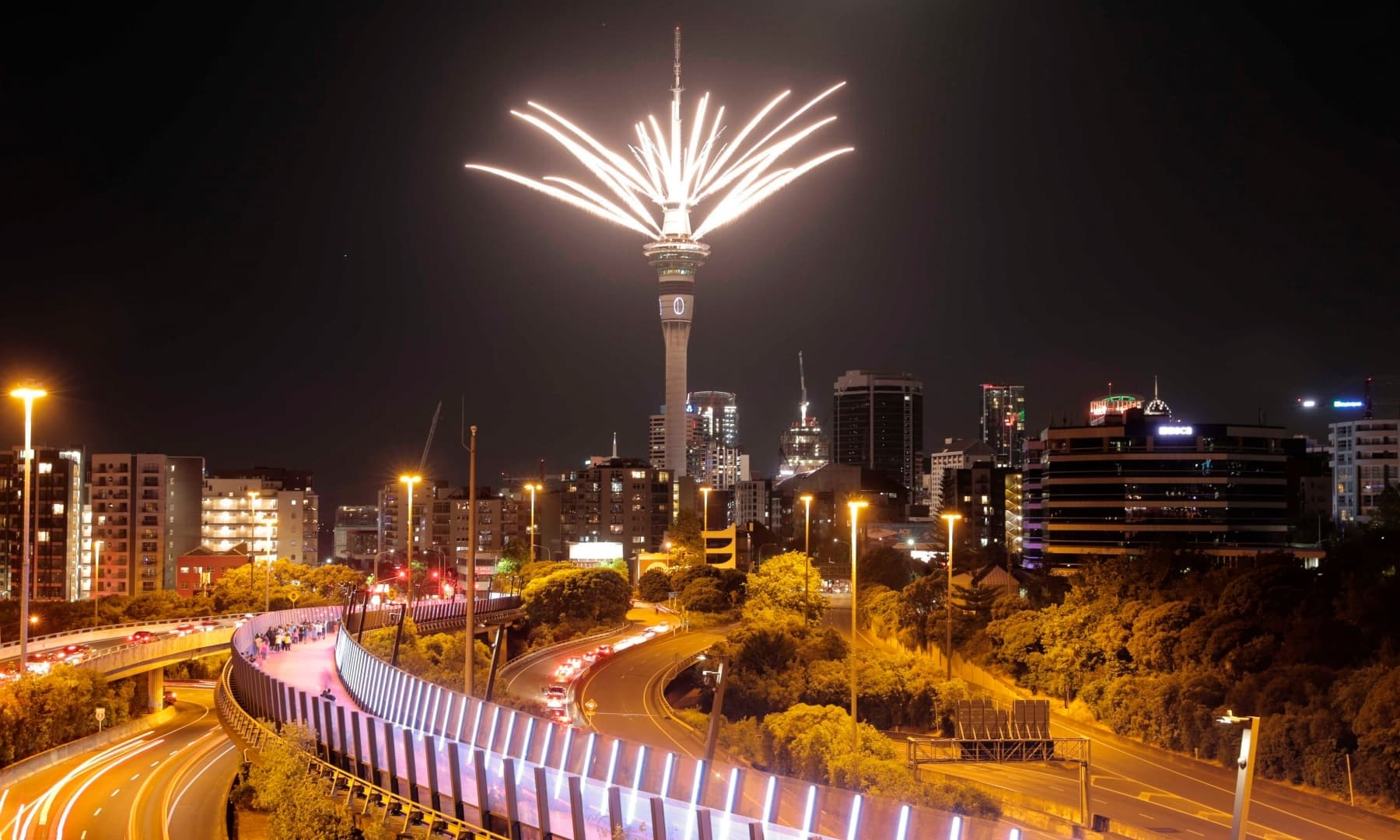 Fireworks are launched from the Sky Tower to mark the changing of the year on New Year's Eve in Auckland, New Zealand, Thursday. — AP