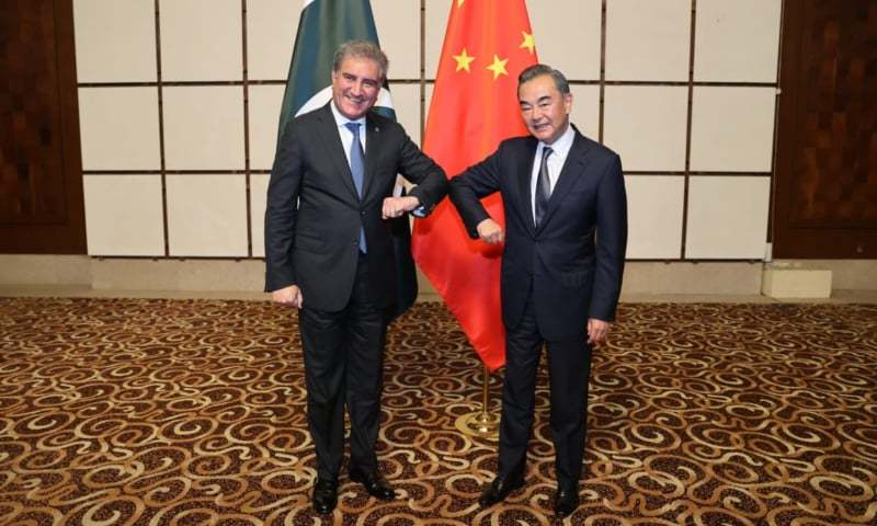 In this file photo, Foreign Minister Shah Mahmood Qureshi and Chinese FM Wang Yi greet each other in Hainan province of China. — Photo courtesy Foreign Office/File