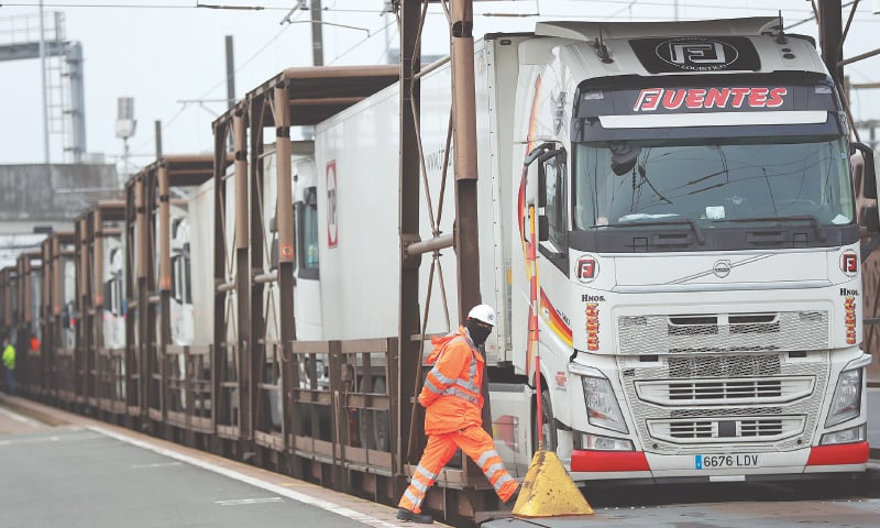 FOLKESTONE (United Kingdom): Lorries are being loaded inside a train bound for Europe at the Eurotunnel on Friday.—AP