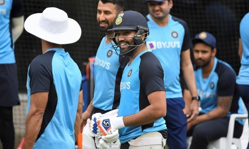 India's Rohit Sharma (C) chats with teammates during a training session at the MCG in Melbourne on January 2. — AFP