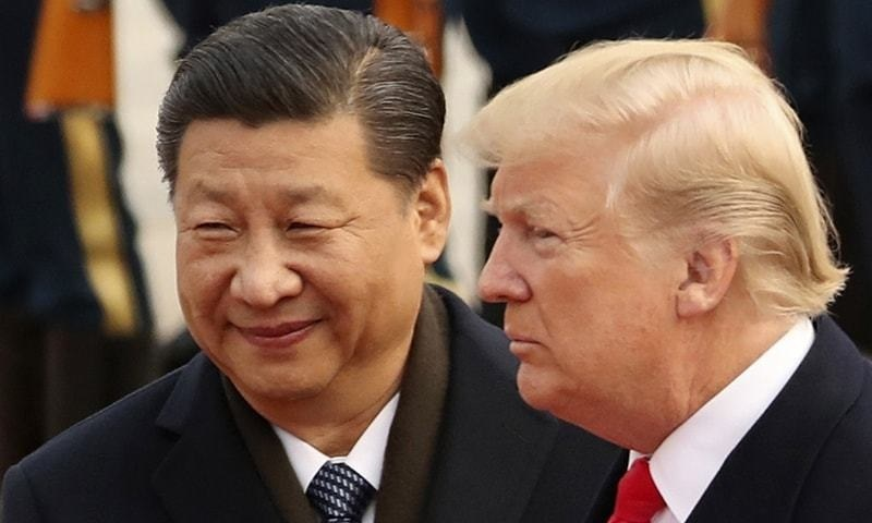 In this Nov 9, 2017, file photo, US President Donald Trump and Chinese President Xi Jinping participate in a welcome ceremony at the Great Hall of the People in Beijing, China. – AP