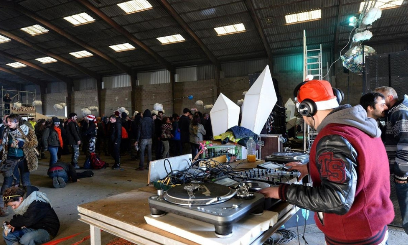 DJs oversee proceedings at a huge illegal rave in a disused warehouse in Brittany, northwestern France, on Dec 31 2020. — AFP