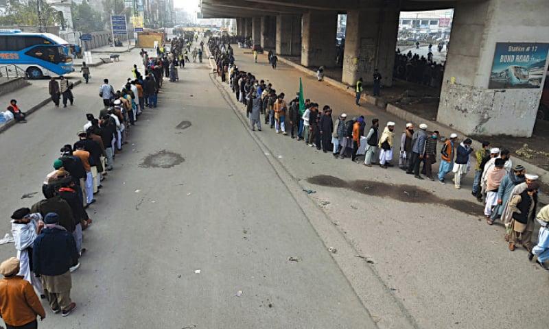 People queue up to attend the Chehlum of Tehreek-i-Labbaik Pakistan former head Khadim Hussain Rizvi near Yateem Khana Chowk on Multan Road. — White Star