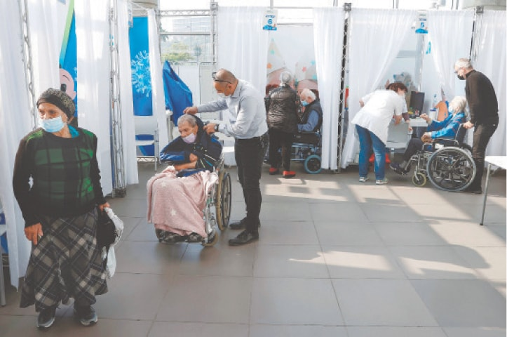 TEL AVIV: People arrive to receive jabs against Covid-19 at a health centre on Sunday. The Israeli government has said that two million people will be vaccinated against the dreaded disease by the end of this month.—AFP
