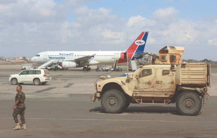 ADEN: A military vehicle is stationed on the tarmac of the airport on Sunday as flights resumed after explosions rocked the building on Dec 30, killing 25 people.—AFP