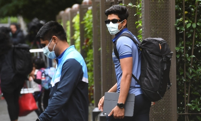 India's Shubman Gill (R) leaves the team's hotel in Melbourne on January 4. — AFP