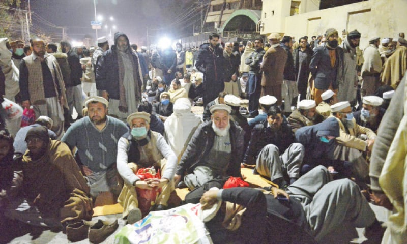 Teachers of government schools stage a sit-in on Khyber Road, Peshawar, on Monday. — White Star