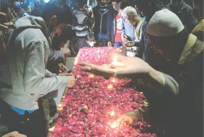 Mourners hold a vigil at Numaish on Tuesday in memory of the Mach victims.—Fahim Siddiqi/Shakil Adil/White Star