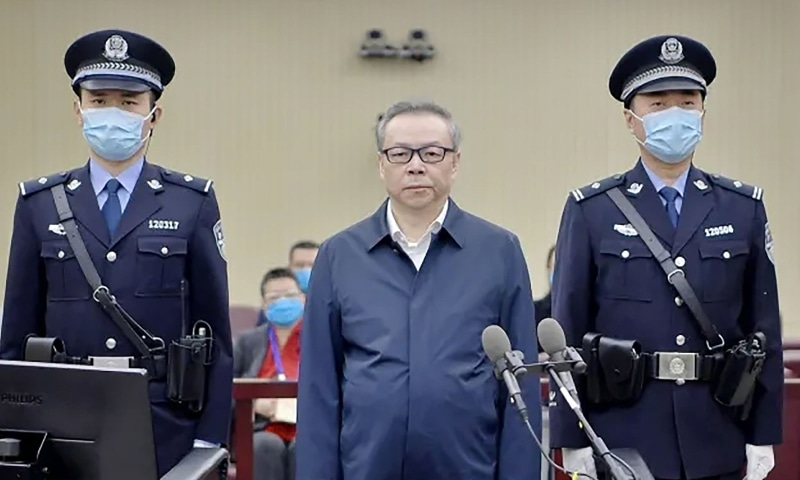 This handout photo taken in August 2020 shows Lai Xiaomin (C), former chairman of China Huarong Asset Management Co., standing during his trial at the Second Intermediate People's Court in Tianjin. — AFP
