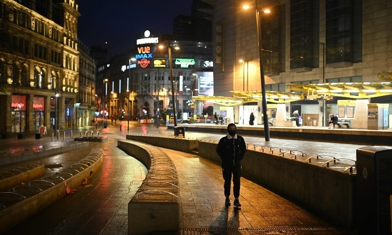 A man walks down a near deserted street in central Manchester, north west England on January 5. — AFP
