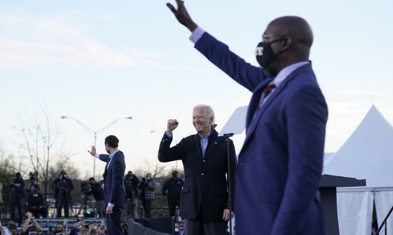 President-elect Joe Biden campaigns in Atlanta on January 4, 2021, for Raphael Warnock, right, and Jon Ossoff, left. — AP