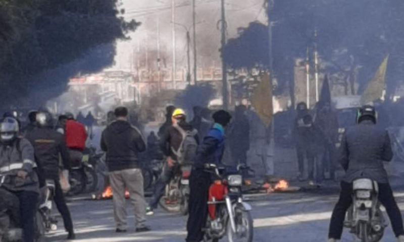 People protesting against the killing of Shia Hazara miners in Balochistan earlier this week, block a road in Karachi on Wednesday. — DawnNewsTV