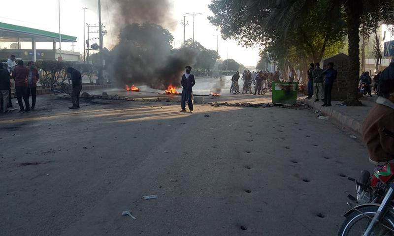 Protesters block a road in Karachi on Wednesday. — DawnNewsTV