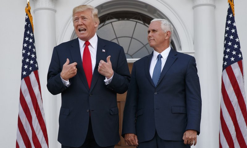 In this file photo, US President Donald Trump, accompanied by Vice President Mike Pence, speaks to reporters before a security briefing at Trump National Golf Club in Bedminster, US. — AP