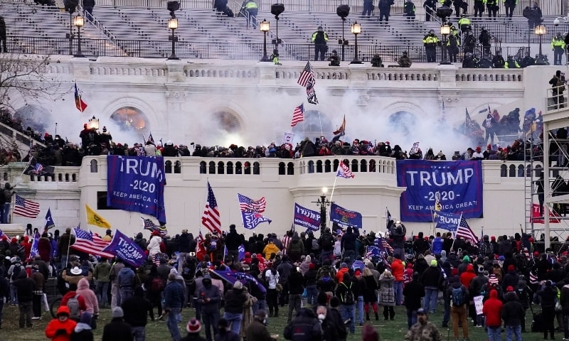 Violent protesters, loyal to President Donald Trump, storm the Capitol, on Jan 6. —  AP