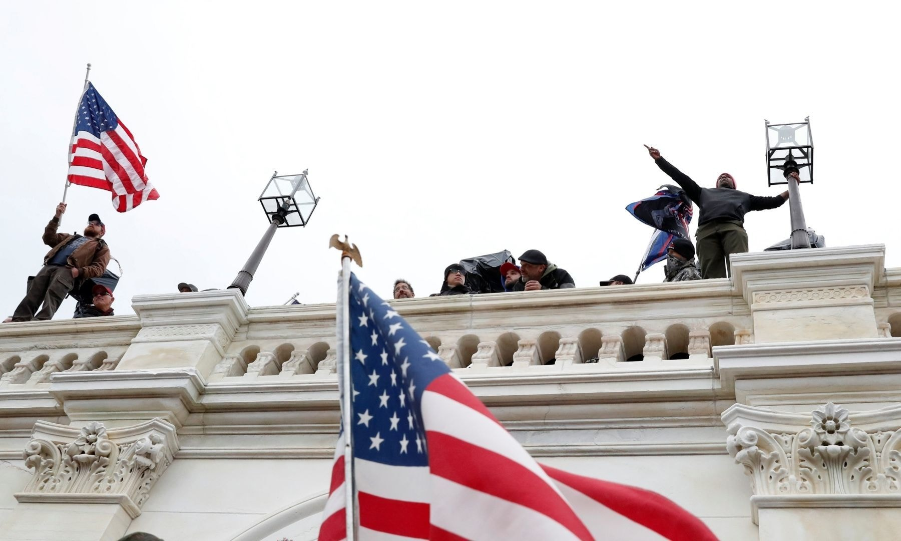 Pro-Trump protesters wave American flags after breaching the Capitol barricades during a rally to contest the certification of the 2020 US presidential election results by the Congress, at the US Capitol Building in Washington on January 6, 2021. — Reuters