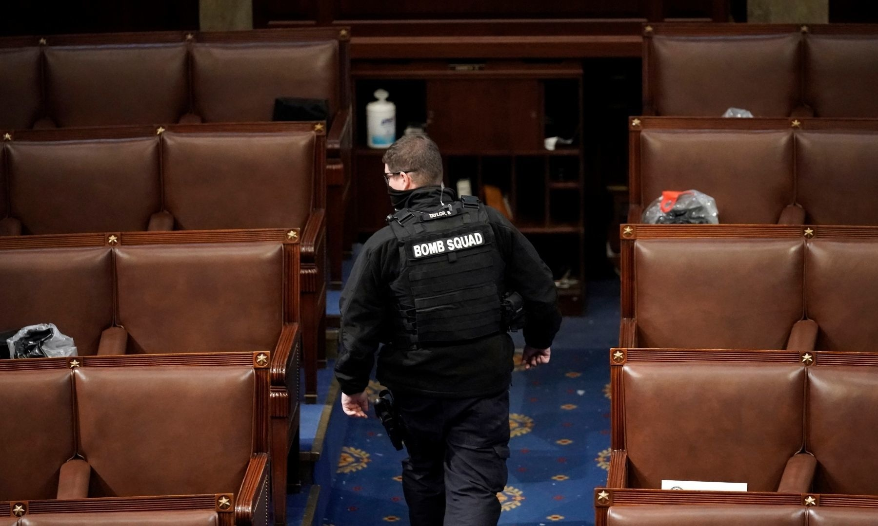 A member of the bomb squad walks on the House floor after protesters who support President Donald Trump broke into the US Capitol. — AP