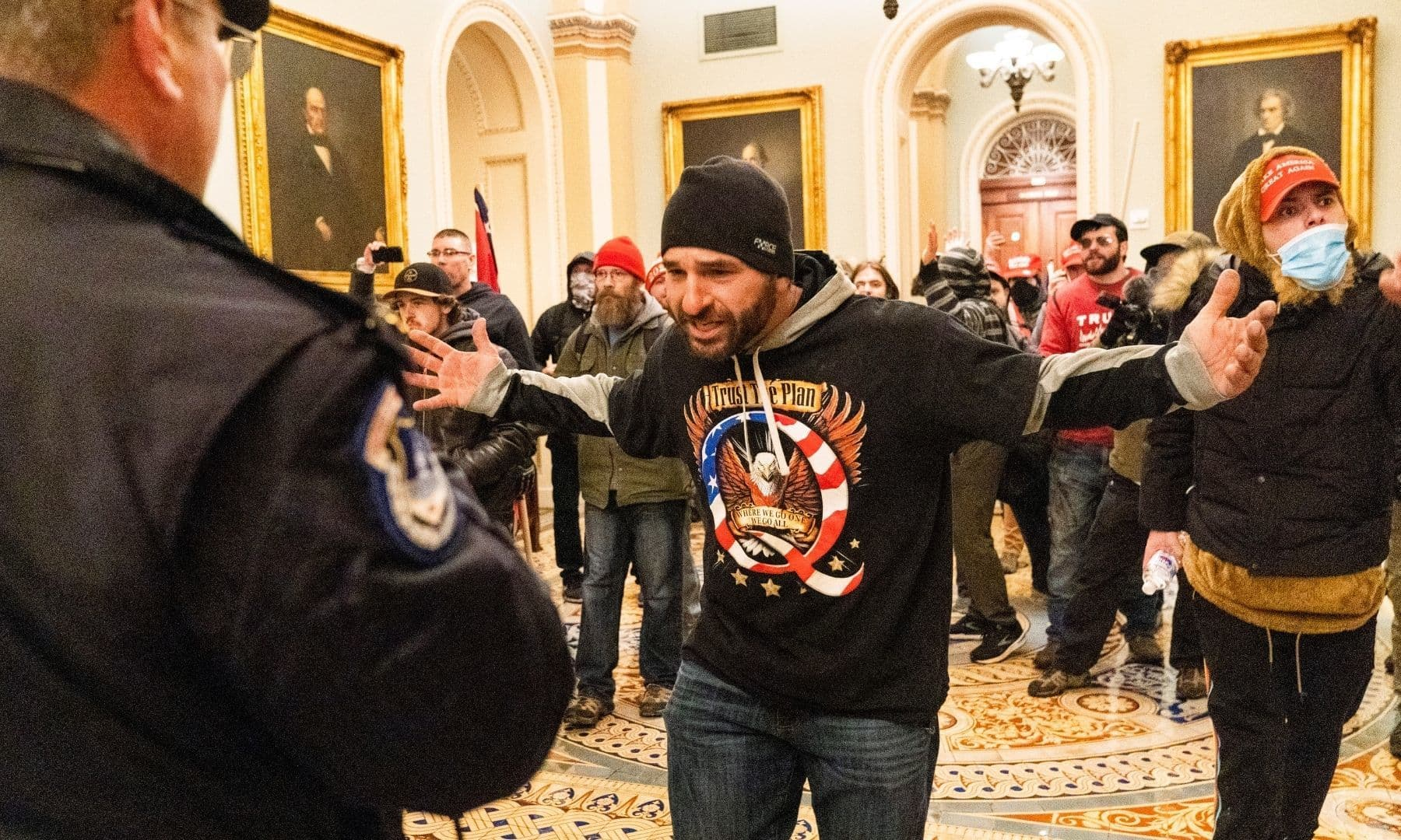 Supporters of President Donald Trump are confronted by Capitol Police officers outside the Senate Chamber at the Capitol. — AP