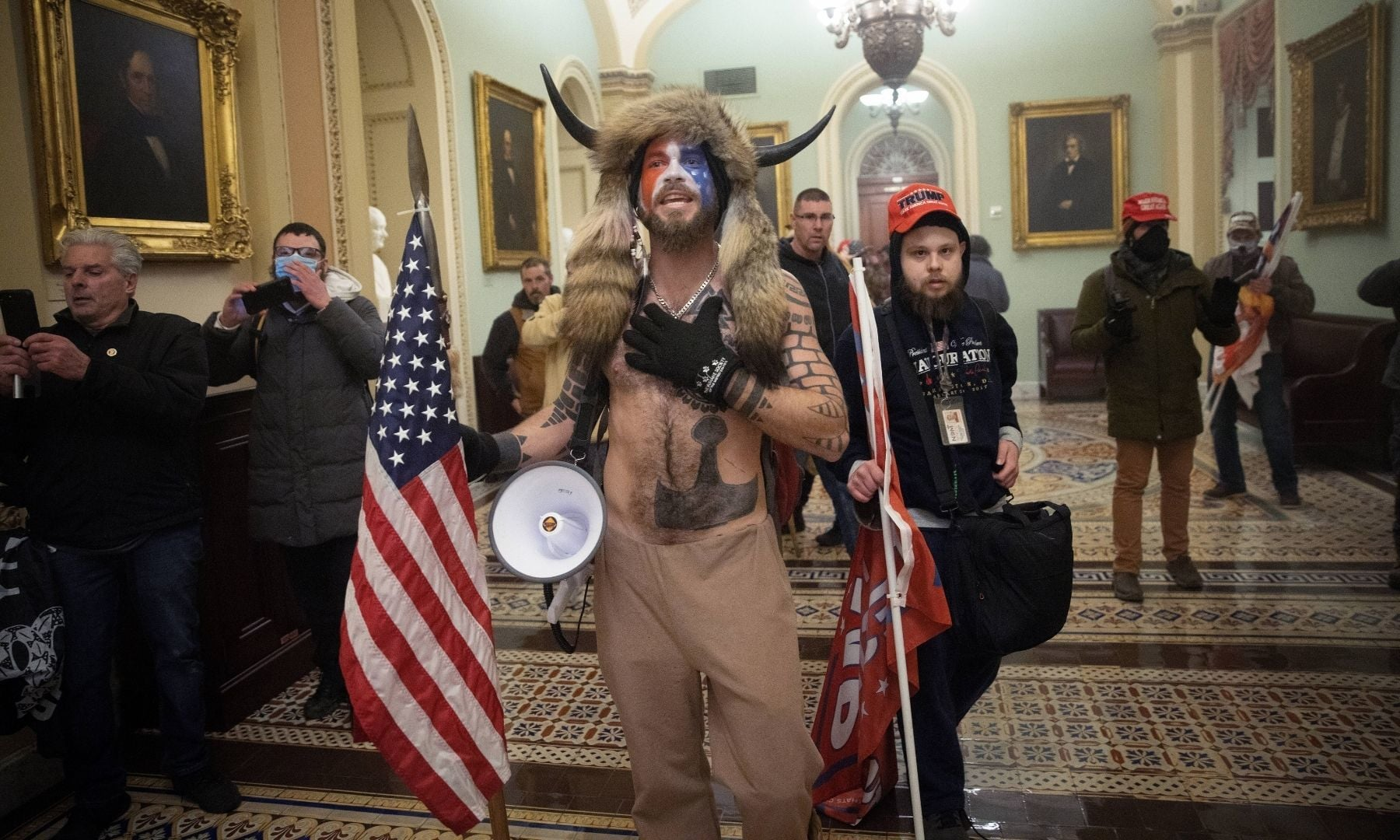 A pro-Trump mob confronts US Capitol police outside the Senate chamber of the Capitol Building. — AFP