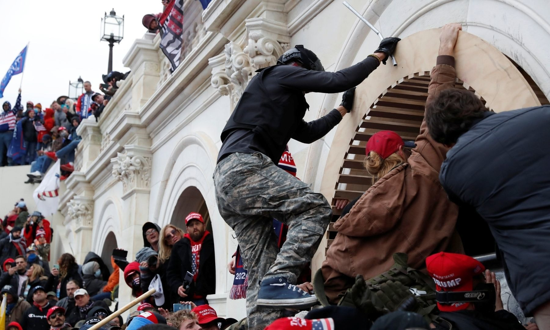 Pro-Trump protesters scale a wall as they storm the US Capitol Building. — Reuters