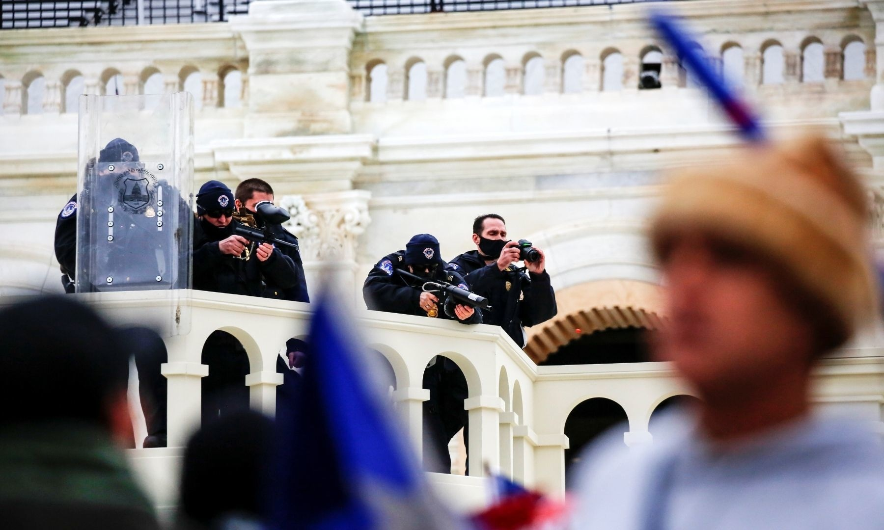 Law enforcement officers aim less-lethal weapons towards supporters of President Donald Trump at the US Capitol. — Reuters