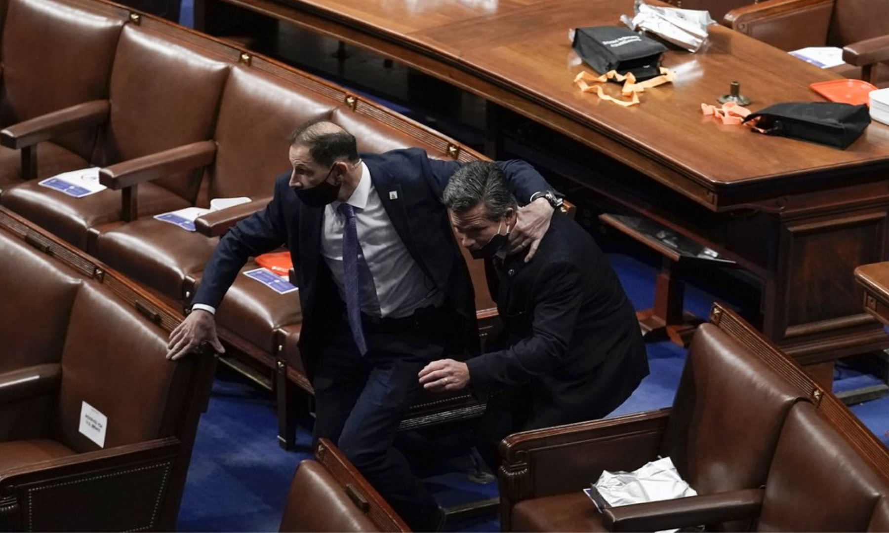 Lawmakers evacuate the floor as protesters try to break into the House Chamber at the U.S. Capitol. — AP