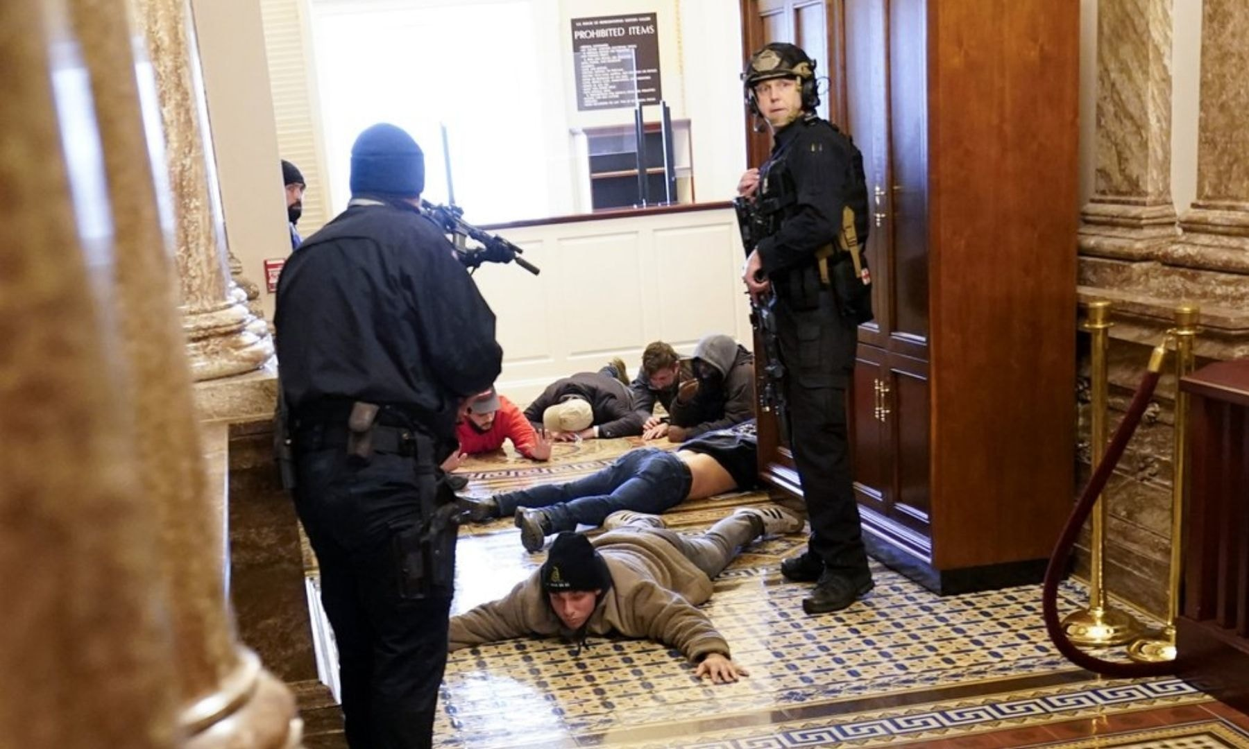 US Capitol Police hold protesters at gun-point near the House Chamber inside the Capitol. — AP