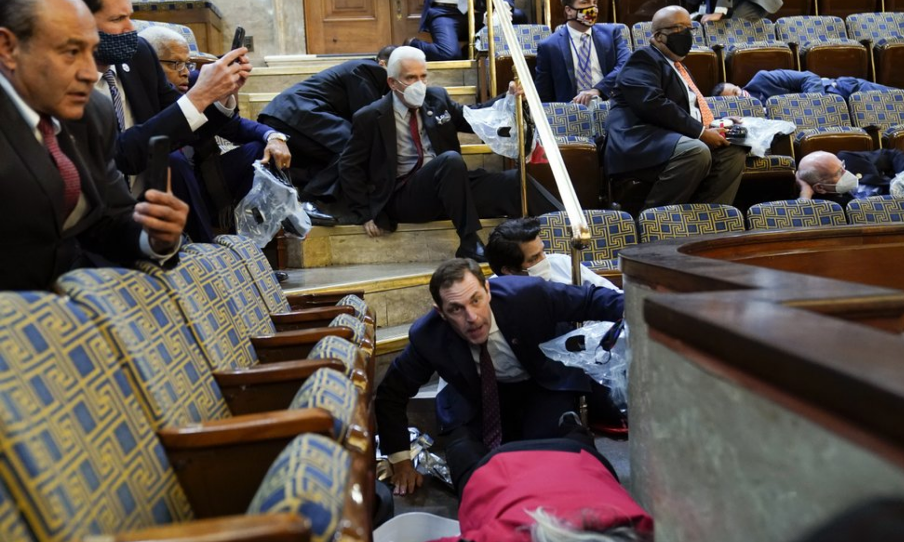 People shelter in the House gallery as protesters try to break into the House Chamber at the US Capitol on January 6, 2021 in Washington, US. — AP