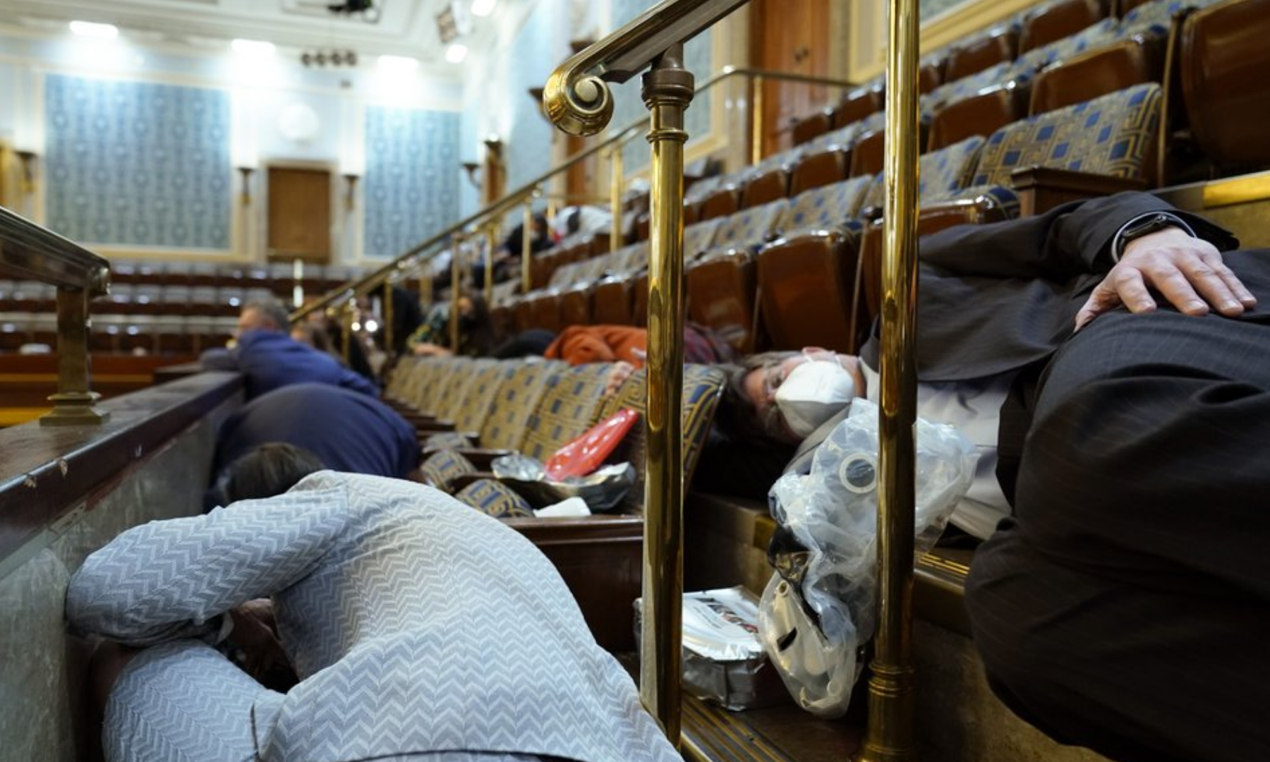 People shelter in the House gallery as protesters try to break into the House Chamber at the US Capitol. — AP