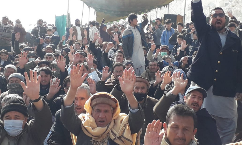 Members belonging to the Shia Hazara community continue to protest for a fifth straight day on Thursday in the western bypass area in Quetta on Thursday. — Photo by Ghalib Nihad