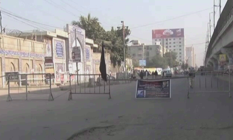 A road is closed off as protests by members of the Shia Hazara community continue in Karachi on Thursday. — DawnNewsTV