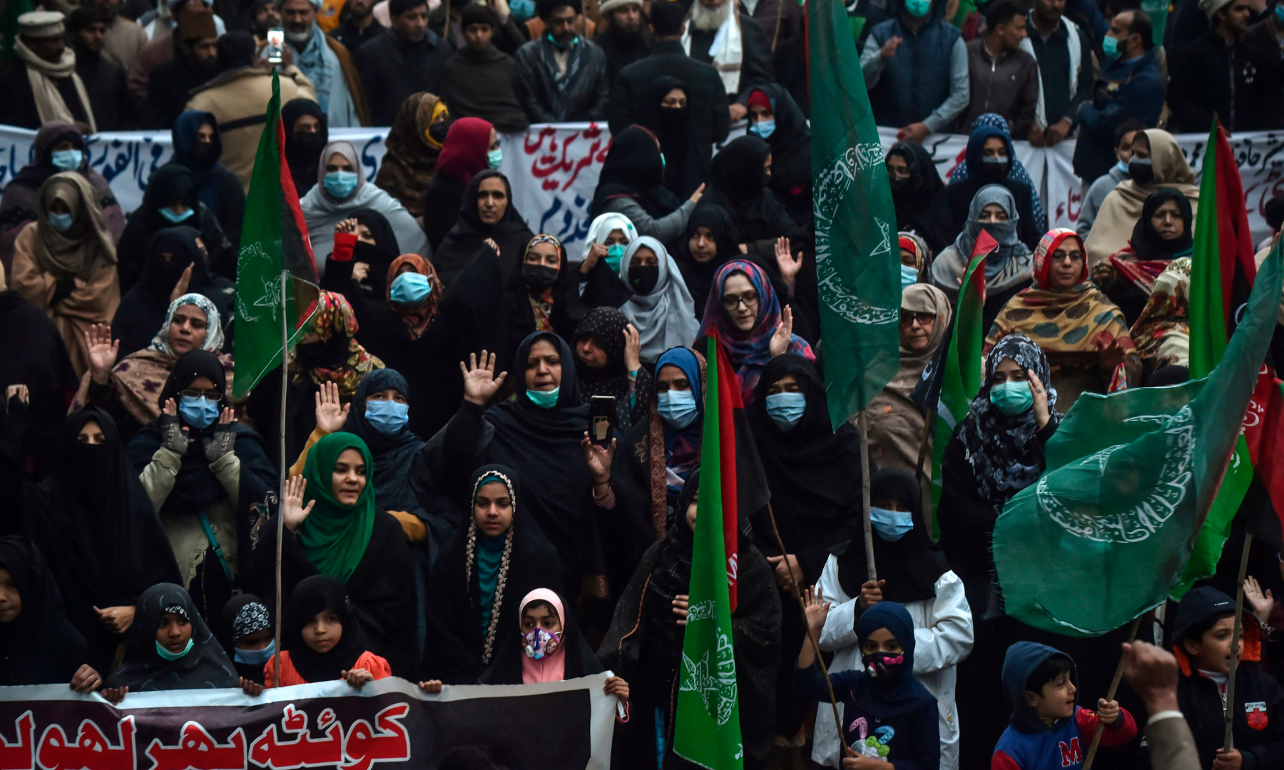 Shia protesters carry placards as they gather during a protest in Lahore on Jan 6. — AFP