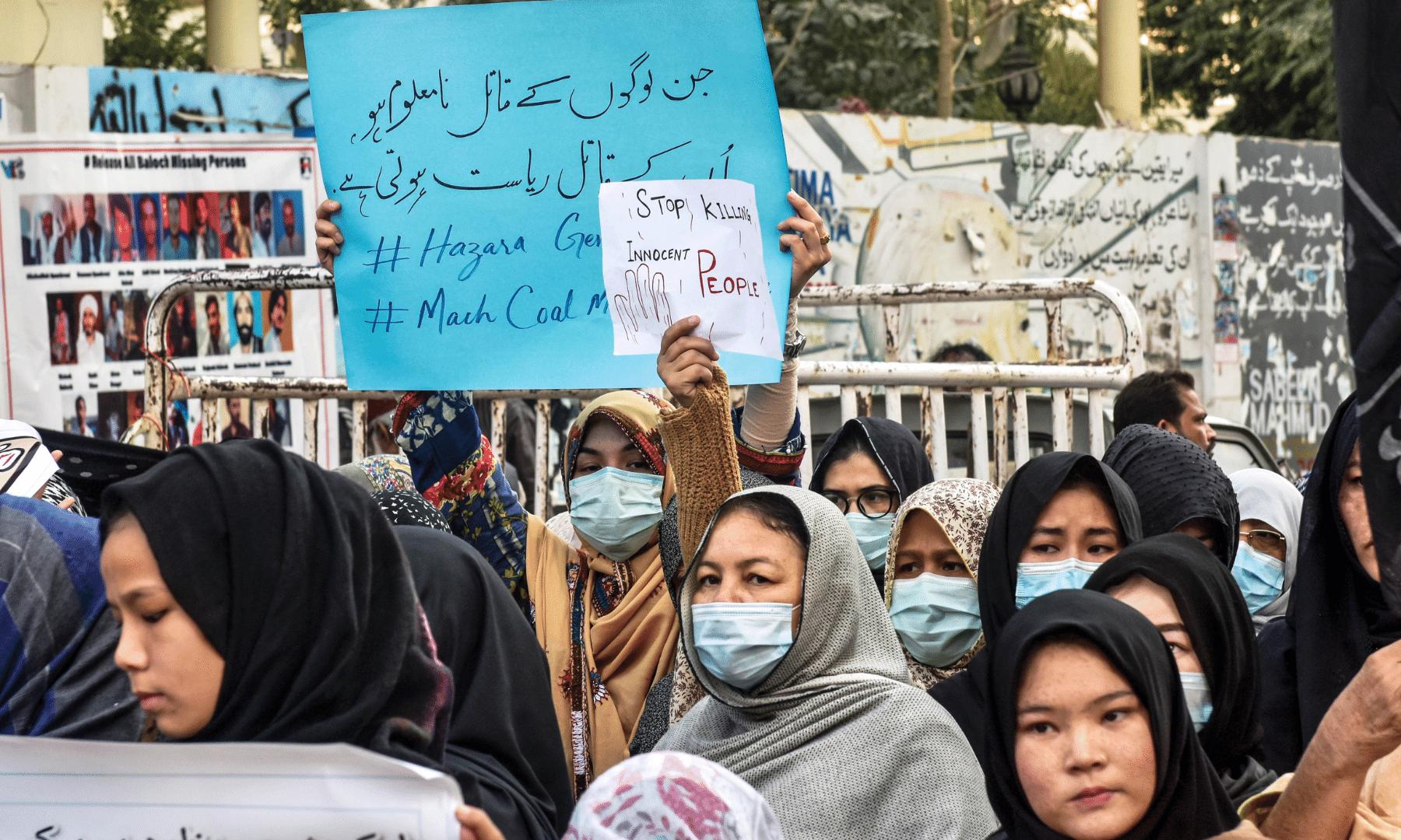 Members of the Shia Hazara community protest outside the Karachi Press Club on Jan 5. — Shakeel Adil/ White Star
