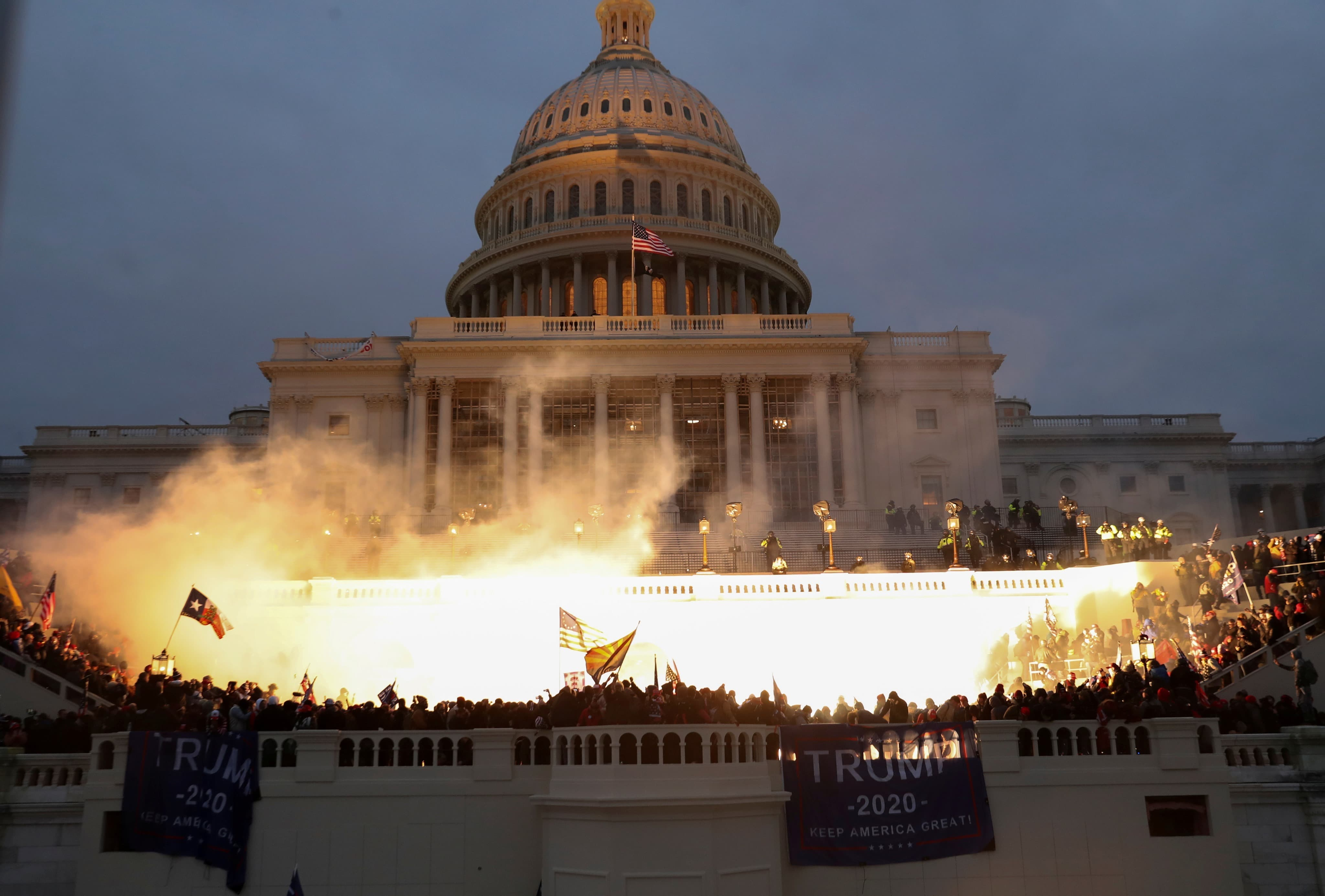 An explosion caused by a police munition is seen while supporters of US President Donald Trump gather in front of the US Capitol Building in Washington, January 6. — Reuters