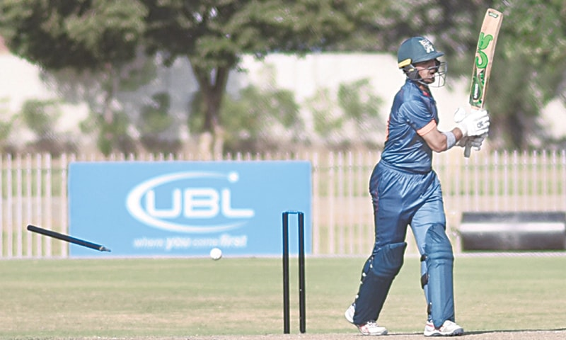 BALOCHISTAN opener Bismillah Khan is cleaned up by Northern all-rounder Hammad Azam at the UBL Sports Complex on Friday.  — PCB