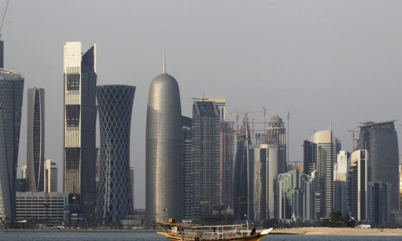 In this file photo, a traditional dhow floats in the Corniche Bay of Doha, Qatar, with tall buildings of the financial district in the background. — AP
